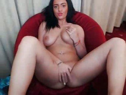 cute busty babe fingerfucks her pussy