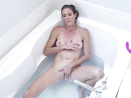 Solo woman treats themselves with some nice toying upon the tub