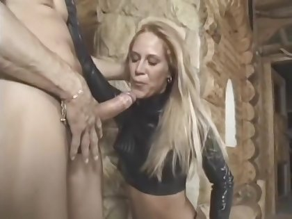 hooded babe in latex and thigh on one's high horse boots gets her ass ploughed