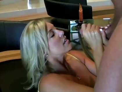 Lusty ash-blonde mother with hefty boobies is inhaling lollipop while acquiring on all fours on the floor and acquiring screwed