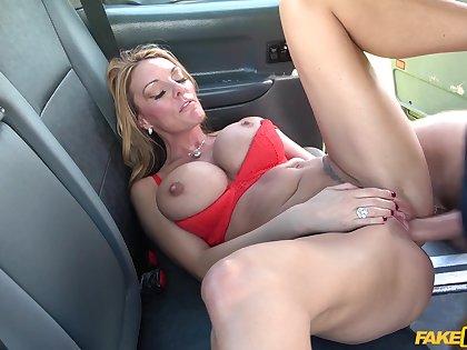 Big-chested bimbo Stacey Saran fucks her taxicab tweeny