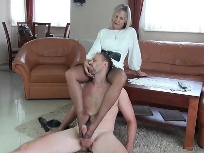 Beautiful MILF in stockings footjob