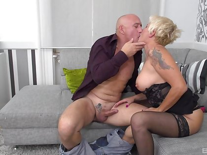 Rough sex for the busty auntie after she sucks like a pro
