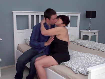 Dark-haired full-grown slut Attilane beds a much younger man