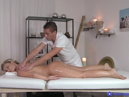 Masseur uses more than his strong arms on a erotic oiled blonde