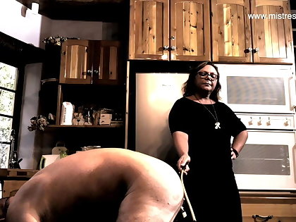 Dominatrix Floss April - caning her slave's ass