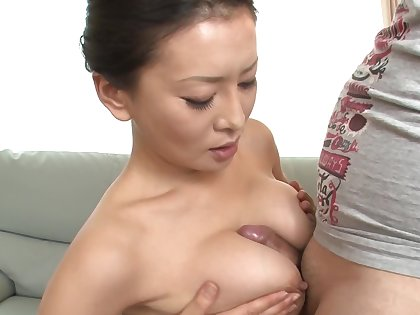 Japanese MILF is taking care of two cocks in a threesome