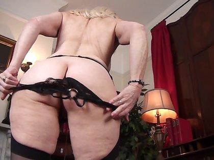 Video of mature chick Margaret Holt pleasuring her wet fuck aperture